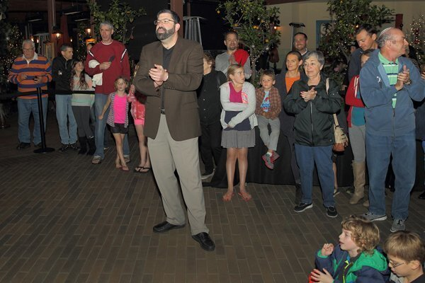 Rabbi David Kornberg leads the Hanukkah celebration at Del Mar Highlands