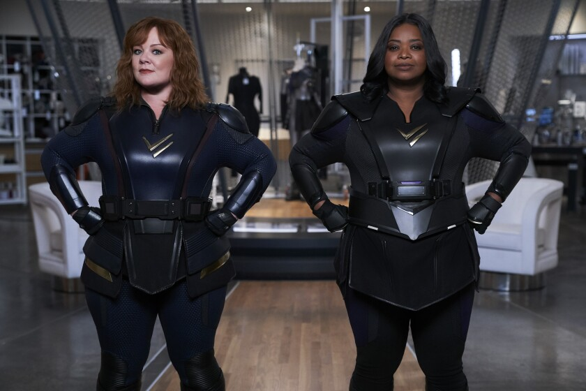 """This image released by Netflix shows Melissa McCarthy, left, and Octavia Spencer in a scene from the comedy """"Thunder Force."""" (Hopper Stone/Netflix via AP)"""