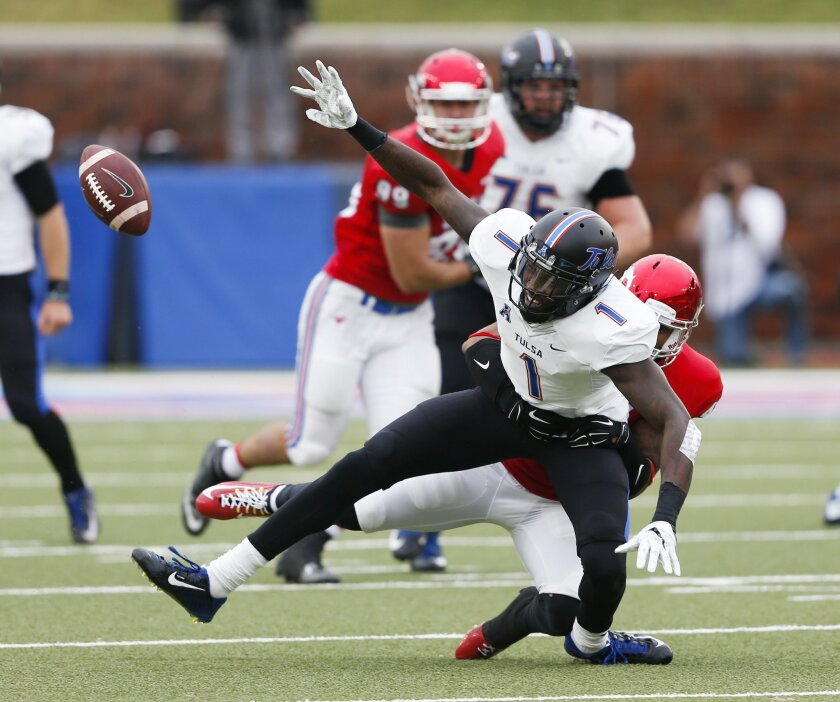 SMU defensive back David Johnson, rear, breaks up the pass to Tulsa wide receiver Keyarris Garrett (1) during the first half of an NCAA college football game, Saturday, Oct. 31, 2015, in Dallas. (AP Photo/Jim Cowsert)