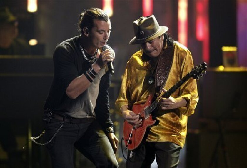 Gavin Rossdale, the leader of the band Bush, is shown performing with former Tijuana guitarist Carlos Santana at the 38th Annual American Music Awards telecast. Rossdale and his band have just announced a new fall leg of their joint tour with fellow band Live that will begin in San Diego.