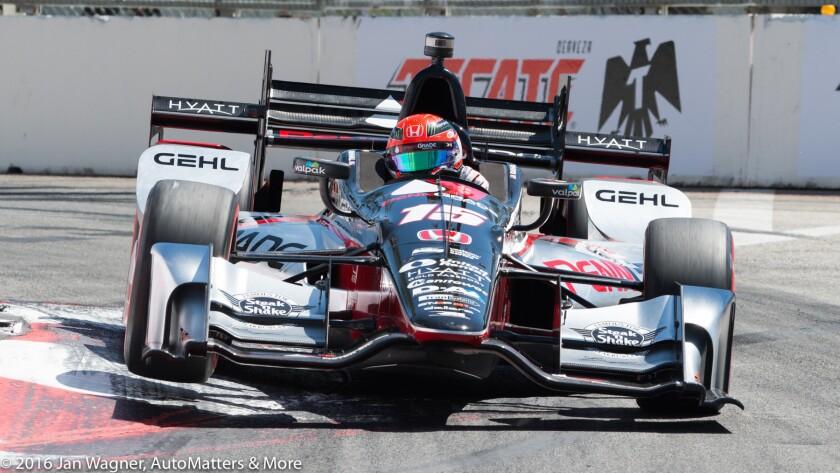 Graham Rahal's IndyCar catches air on a curb