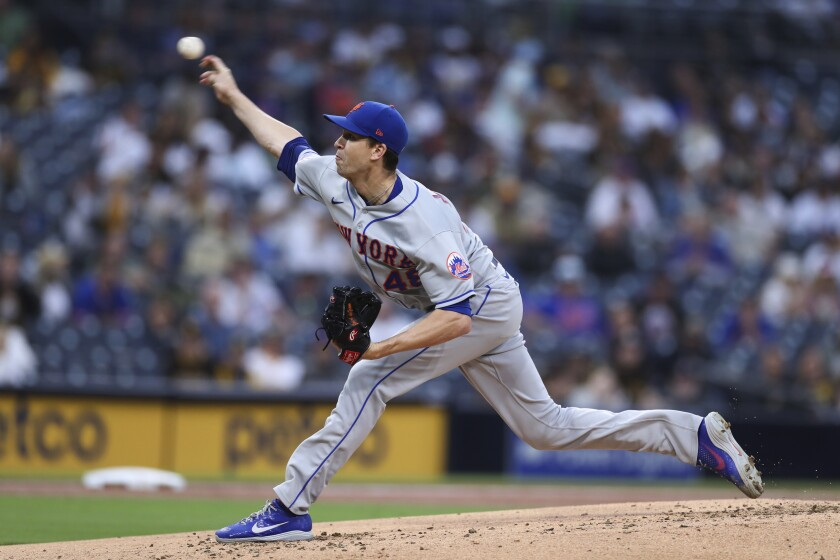 New York Mets starting pitcher Jacob deGrom delivers a pitch in the first inning of the team's baseball game against the San Diego Padres on Saturday, June 5, 2021, in San Diego. (AP Photo/Derrick Tuskan)