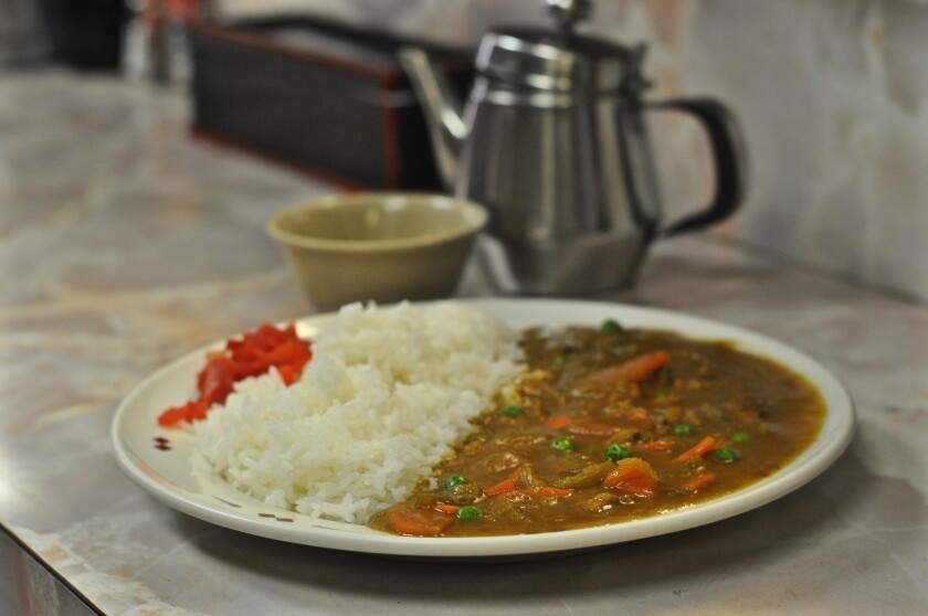 A plate of curry rice waits to be eaten at Mitsuru Cafe in L.A.'s Little To