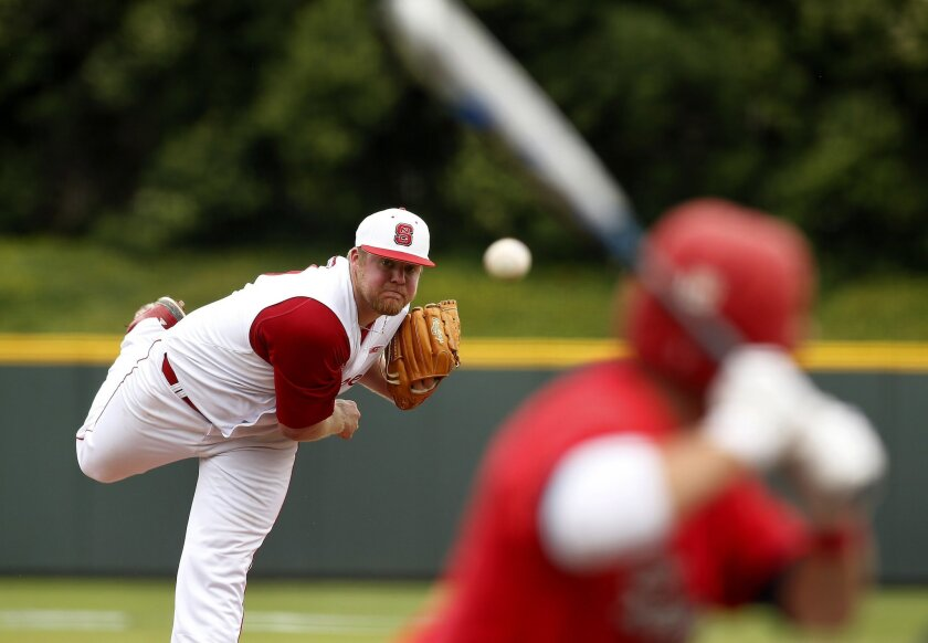North Carolina State pitcher Curt Britt, left throws against Stony Brook in the second inning at the Fort Worth Regional of the NCAA college baseball tournament in Fort Worth, Texas, on Friday, May 29, 2015. N.C. State won 3-0. (AP Photo/Brad Loper)