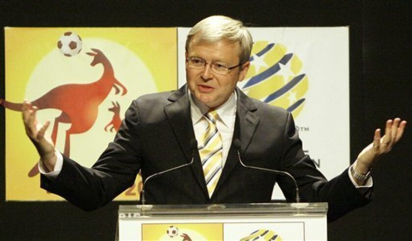 FILE - In this file photo from June 14, 2009, Australia's then Prime Minister Kevin Rudd speaks at Parliament House in Canberra, Australia. Rudd was named Saturday Sept. 11, 2010, as Australia's new foreign minister, a high-profile and coveted posting that will be seen as a consolation prize for being ousted from the leadership. (AP Photo/Rob Griffith, File)