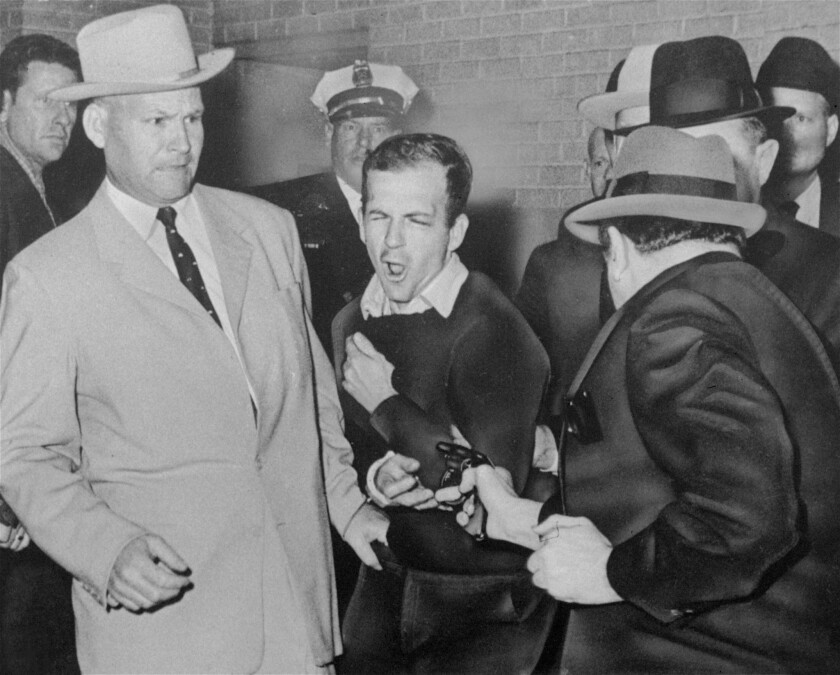 Jack Ruby, in foreground, shoots Lee Harvey Oswald at Dallas police headquarters on Nov. 24, 1963.