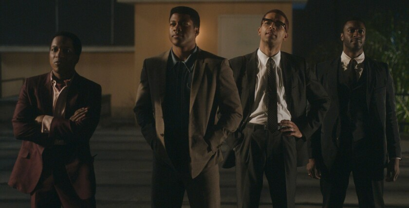 "This image released by Amazon Studios shows Leslie Odom Jr., from left, Eli Goree, Kingsley Ben-Adir and Aldis Hodge in a scene from ""One Night in Miami."" (Amazon Studios via AP)"