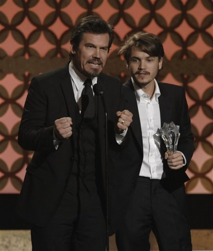 Actors Josh Brolin, left, and Emile Hirsch accept the best acting ensemble award for 'Milk' at the 14th Annual Critics' Choice Awards on Thursday Jan. 8, 2009 in Santa Monica, Calif. (AP Photo/Chris Pizzello)