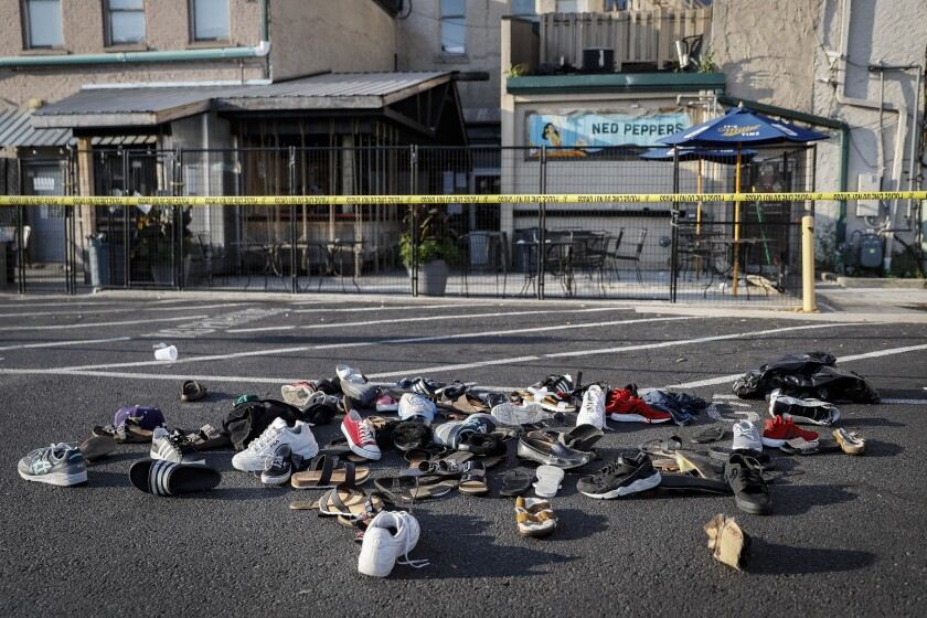 Shoes are piled outside the scene of a mass shooting in Dayton, Ohio.