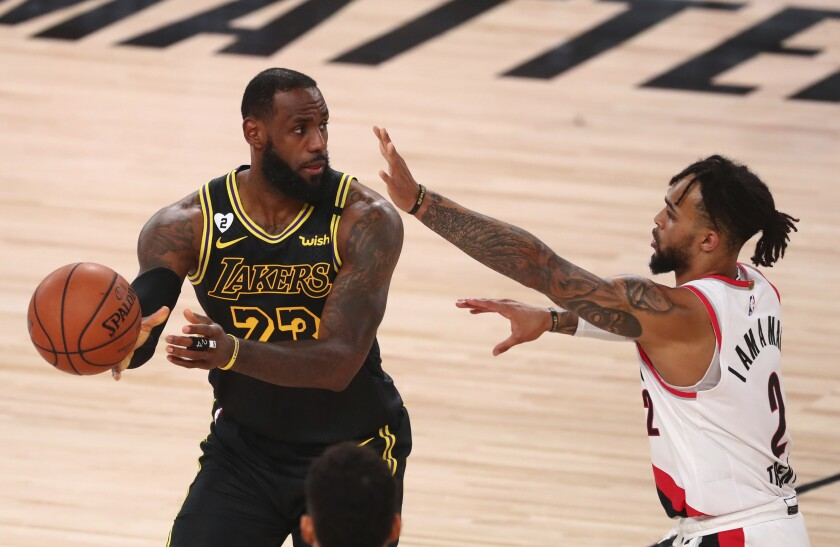 LeBron James controls the ball in front of Portland guard Gary Trent Jr. during Game 4.