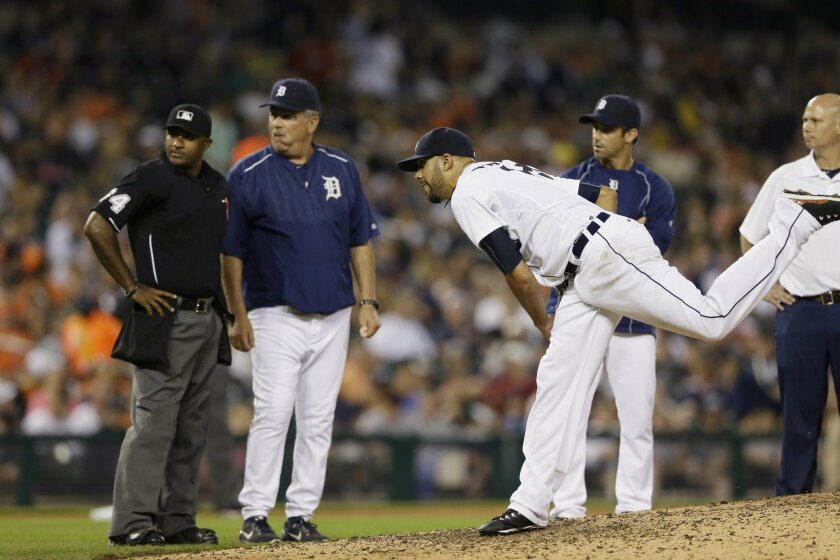 Detroit Tigers starting pitcher David Price throws as home plate umpire Alan Porter, left, Detroit Tigers pitching coach Jeff Jones and manager Brad Ausmus observe during the seventh inning of a baseball game against the Kansas City Royals, Friday, May 8, 2015, in Detroit. Price was relieved. (AP P