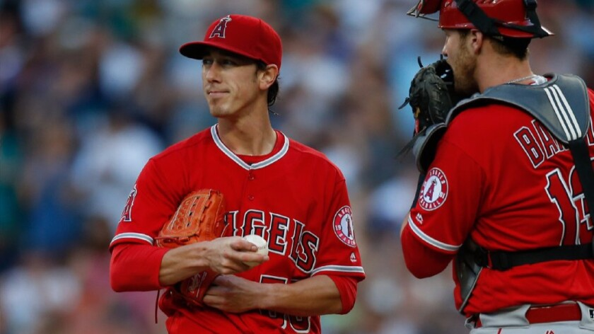 Tim Lincecum, getting a visit from catcher Jett Bandy, is leaving the Angels with a 9.16 earned-run average in nine starts.