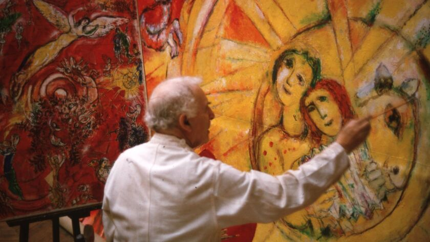 Marc Chagall working on panels for a set for New York's Metropolitan Opera in his Paris studio, 1966