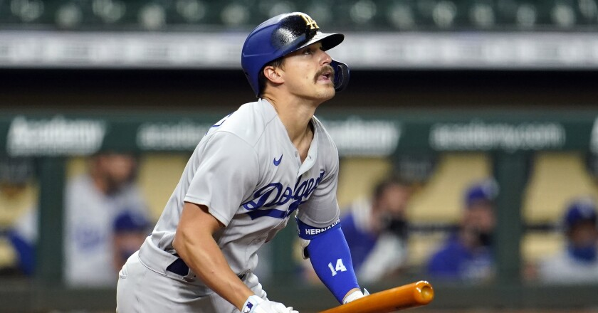 Los Angeles Dodgers' Enrique Hernandez watches his fly ball