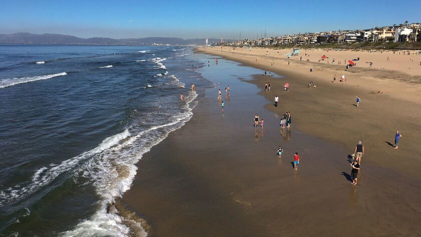 Clear skies are seen in Manhattan Beach, Calif., Sunday, Jan. 28, 2018. Powerful winds are whipping