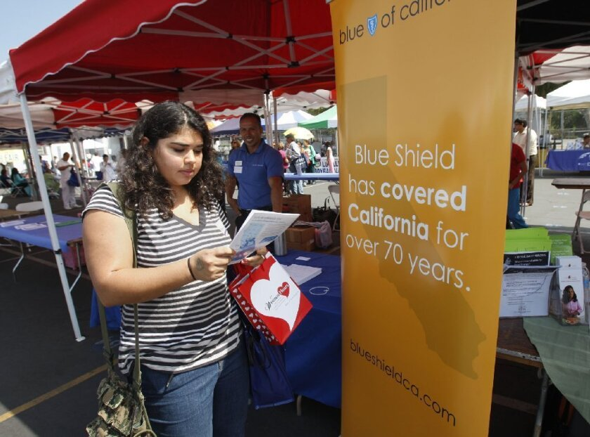 Blue Shield of California tries to enroll people at a recent Los Angeles health fair. The company has agreed to buy GemCare Health Plan.