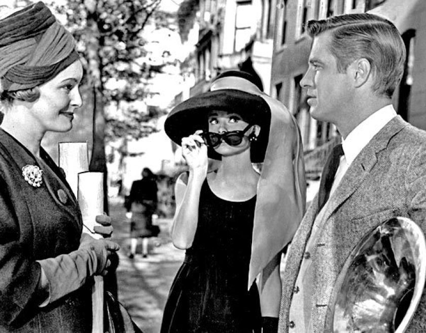 """From left, Patricia Neal, Audrey Hepburn and George Peppard in a scene from """"Breakfast at Tiffany's,"""" director Blake Edward's classic film. See full story"""