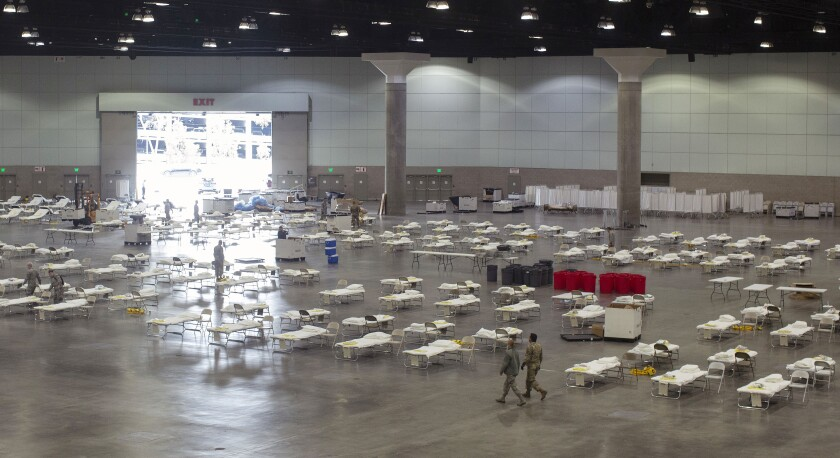 Cots line the floor of the Los Angeles Convention Center for its possible use as a field hospital.