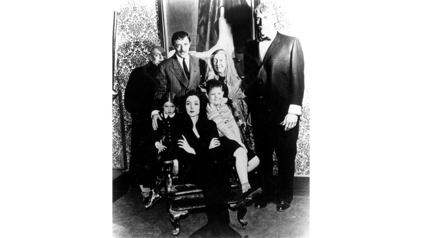 "Jackie Coogan (top left), John Astin, Blossom Rock, Ted Cassidy, Lisa Loring (lower left), Carolyn Jones and Ken Weatherwax in the television show ""The Addams Family."""