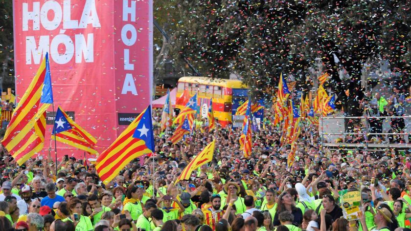 People wave pro-independence Catalan flags at a demonstration on Sept. 11, 2017, in Barcelona, Spain, during the National Day of Catalonia.