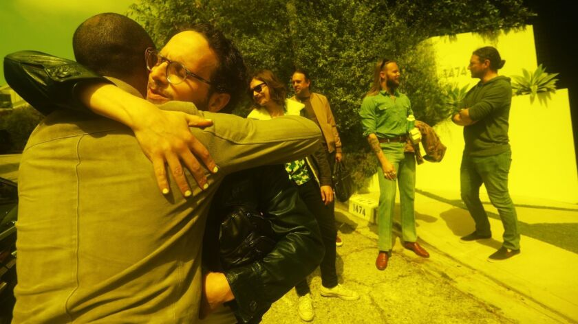 LOS ANGELES, CA - JUNE 3, 2019 - - An emotional Salem Al Fakir, facing camera, hugs Aloe Blacc, in f