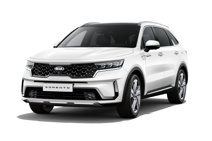 The upcoming Sorento features sharper lines and elongated proportions. A European model is shown.