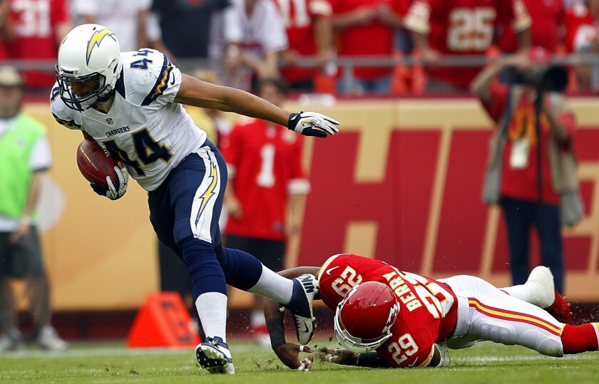 Chargers Jackie Battle gets by Chiefs Eric Berry in the 1st quarter on Sunday, Sept. 30, 2012.