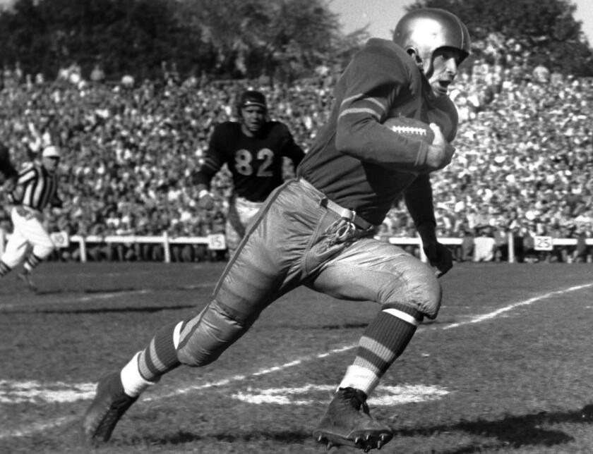 Al Carmichael on the football field in 1953.