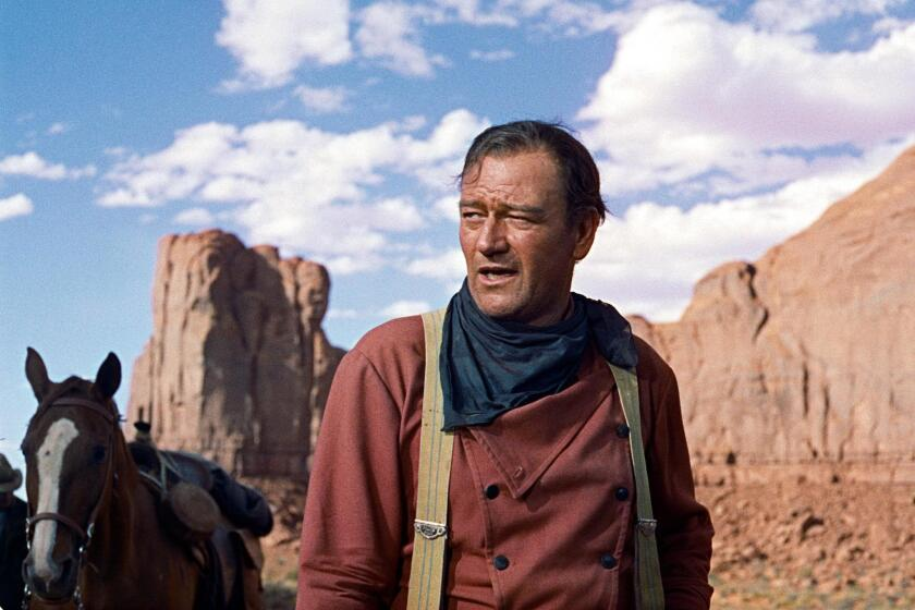 """John Wayne in the film """"The Searchers."""" Newport Beach Mayor Kevin Muldoon wants to rename a park after the late actor as a companion to the city's John Wayne Day."""