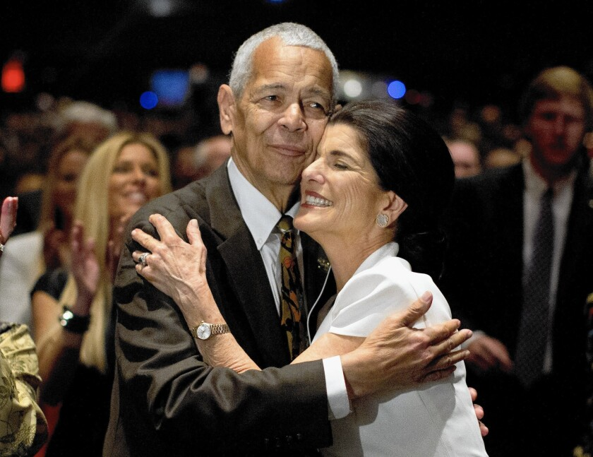 Social activist Julian Bond hugs Luci Baines Johnson, daughter of President Lyndon B. Johnson, during the Civil Rights Summit in April 2014. Bond has died at 75.