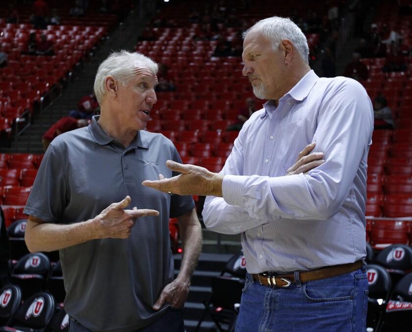 Former NBA centers Bill Walton, left, and Mark Eaton talk before a Utah-Arizona college basketball game.