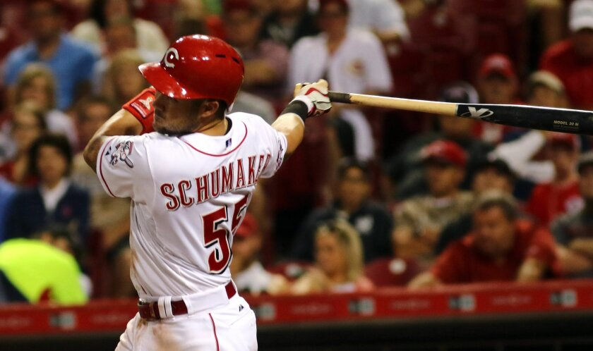Cincinnati Reds Skip Schumaker hits a two-run single against the Detroit Tigers in the sixth inning of their baseball game in Cincinnati, Monday Aug. 24, 2015. (AP Photo/Tom Uhlman)