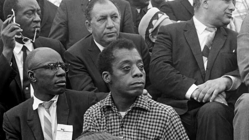 Writer James Baldwin listens to the Rev. Martin Luther King Jr. at the culmination of the Selma to Montgomery March in Alabama in March 1965.