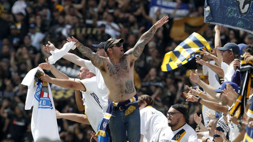 CARSON, CALIF. - MAR 31, 2018. Los Angeles Galaxy fans celebrate after their team beat LAFC in thei