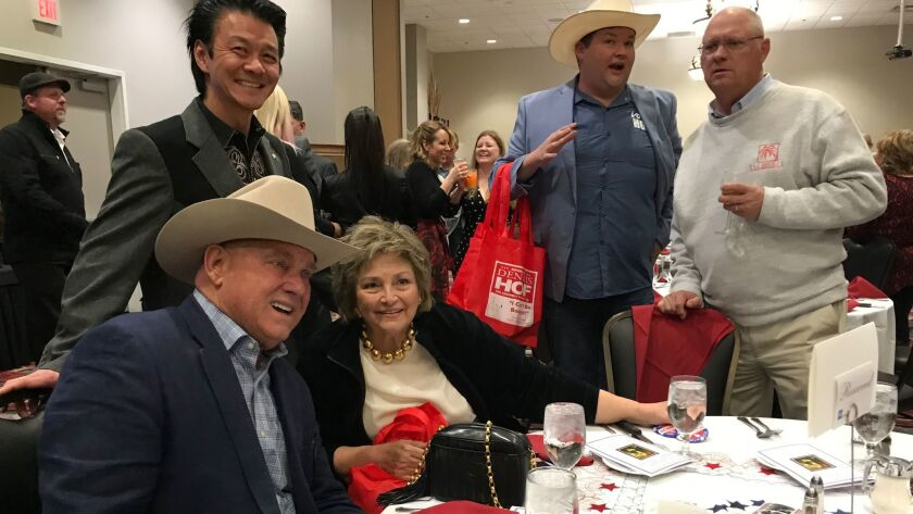 Dennis Hof, seated at left, joins a group at the 39th Lincoln Day Dinner hosted by the Pahrump Valley Republican Women and Nye County Republican Central Committee.