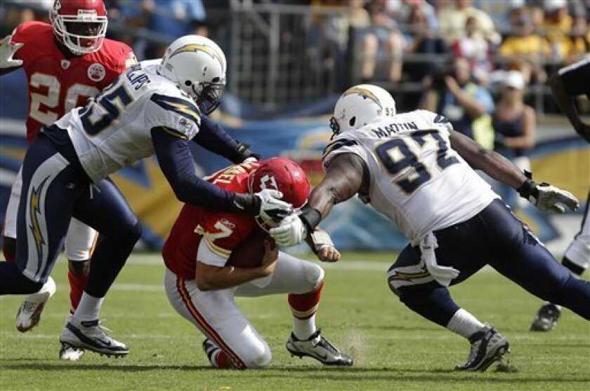 Kansas City Chiefs quarterback Matt Cassel is sacked by San Diego Chargers defensive end Vaughn Martin (92) , and outside linebacker Shaun Phillips (95) in the second half of an NFL football game Sunday, Sept. 25, 2011, in San Diego. (AP Photo/Lenny Ignelzi)