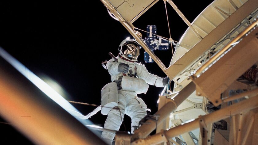 In this August 1973 photo made available by NASA, astronaut Owen K. Garriott retrieves an imagery ex
