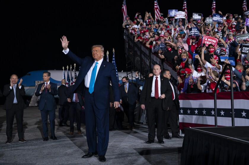 President Donald Trump arrives for a campaign rally at Harrisburg International Airport, Saturday, Sept. 26, 2020, in Middletown, Pa. (AP Photo/Evan Vucci)