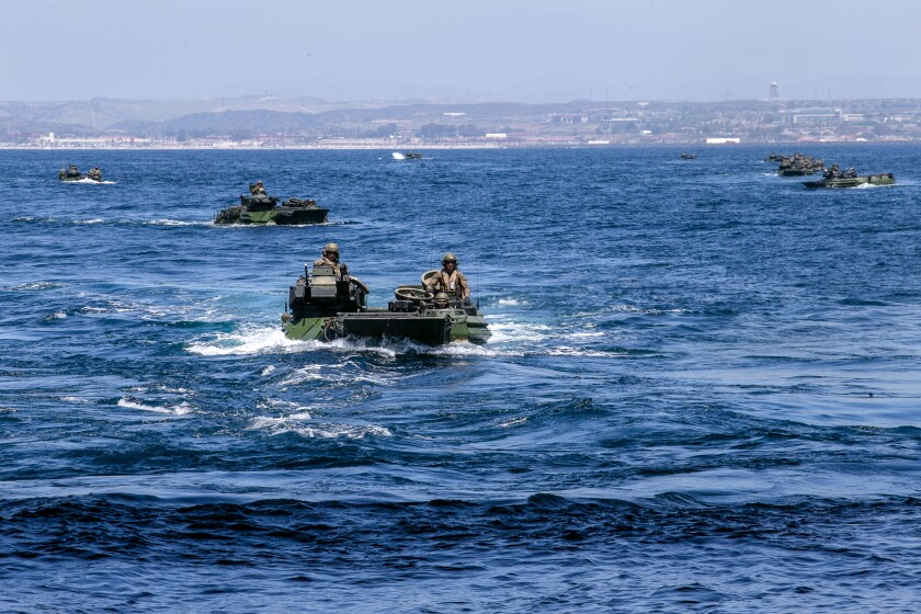 U.S. Marines with Battalion Landing Team 1/4, 15th Marine Expeditionary Unit, operate assault amphibious vehicles.