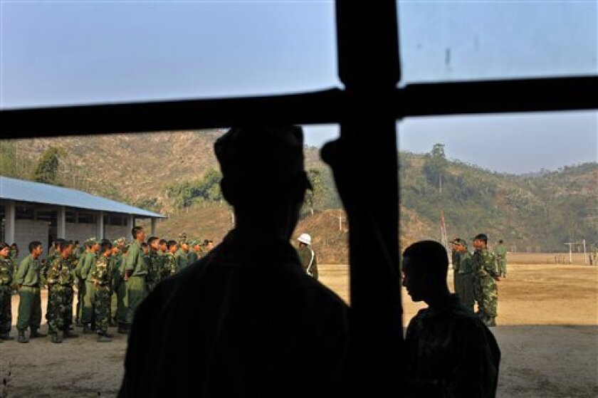 In this Feb. 13, 2012 photo, recruits of the Kachin Independence Army, one of the country's largest armed ethnic groups, receive training at a military camp near Laiza, the area controlled by the Kachin in northern Myanmar. The Kachin ethnic minority was promised its freedom in 1948, and is still waiting for the military-backed government to deliver. Meanwhile, the war continues to generate waves of refugees and allegations of atrocities. (AP Photo/Vincent Yu)