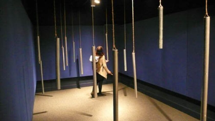 Sarah rebolloso McCullough plays the tubular grieving bells. Photos by Will Bowen