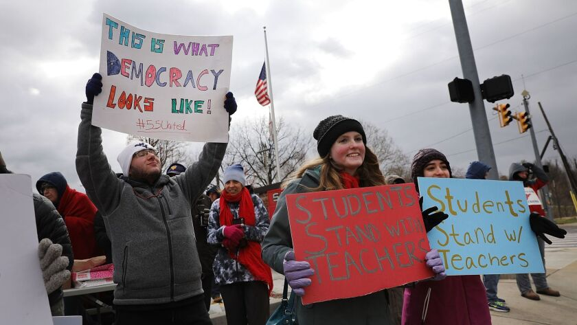 West Virginia teachers, students and supporters gather on a street in Morgantown to show their support for striking teachers, who are asking for pay raises.