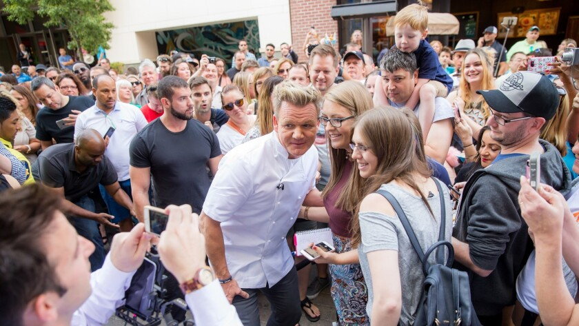 Celebrity chef Gordon Ramsay poses for photos with fans outside his newly opened fish-and-chips shop in Las Vegas on Oct. 7.
