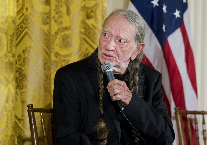 Singer Willie Nelson responds to a question during a special daytime workshop for high school students from military communities in the greater Washington area, Thursday, Nov. 6, 2014, in the East Room of the White House in Washington,  hosted by first lady Michelle Obama.  (AP Photo/Manuel Balce C