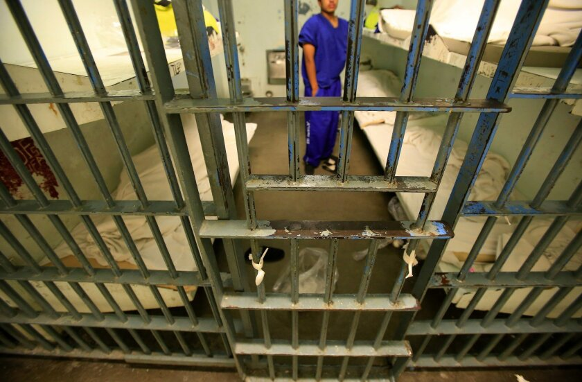 An inmate in a six-bunk cell inside the Men's Central Jail in August 2014. Los Angeles County will use a foundation grant to develop a plan for reducing the number of people locked up in county jails.
