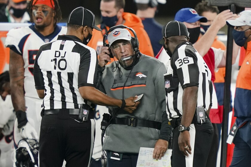 Denver Broncos head coach Vic Fangio talks to officials during the first half of an NFL football game against the New York Jets Thursday, Oct. 1, 2020, in East Rutherford, N.J.Maybe the third time will actually bring a kickoff between for the Denver Broncos and New England Patriots. After having their original Week 5 matchup twice postponed because of a mini outbreak of coronavirus cases on the Patriots that saw four players including quarterback Cam Newton and reigning Defensive Player of the Year Stephon Gilmore test positive, the teams are hopeful they will finally meet this week. (AP Photo/John Minchillo)