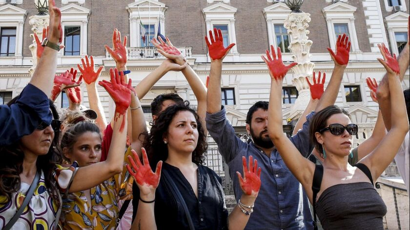 Demonstrators in Rome decry the immigration policies of Italian Interior Minister Matteo Salvini on July 18, 2018.