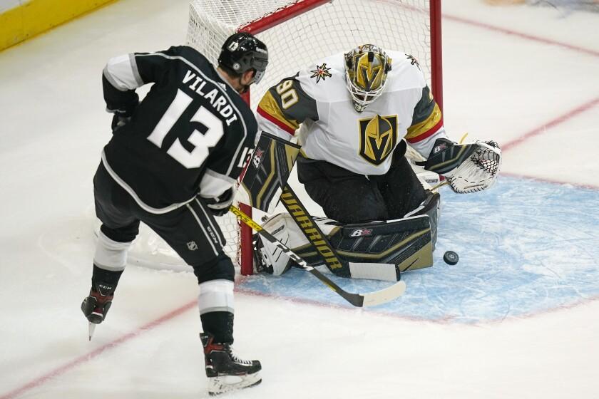 Vegas Golden Knights goaltender Robin Lehner (90) makes as save against Los Angeles Kings center Gabriel Vilardi (13) during the first period of an NHL hockey preseason game Thursday, Sept. 30, 2021, in Salt Lake City. (AP Photo/Rick Bowmer)