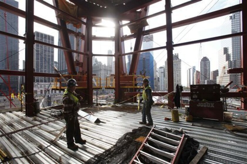 In this photo made Tuesday, Nov. 17, 2009, work continues on the construction of One World Trade Center. The Labor Department on Thursday, Dec. 3, 2009 said productivity was rising at an annual rate of 8.1 percent in July-September period, the biggest jump since 2003, while unit labor costs were falling at a 2.5 percent rate. (AP Photo/Mark Lennihan)