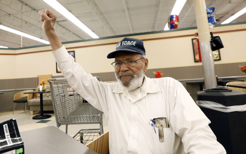 """FILE - In this July 19, 2018, file photo, civil rights movement activist James Meredith, right, greets a friend with a black power salute as he takes a coffee break at a north Jackson, Miss., grocery store. """"Walk Against Fear: James Meredith,"""" scheduled to air Thursday, Oct. 1, 2020, on the Smithsonian Channel, examines the life of a U.S. Air Force veteran-turn-human right agitator whose admission into the University of Mississippi forced President John F. Kennedy to send federal troops into the state to quell a white supremacy uprising. It was one of the most violent moments of the Civil Rights Movement and it forever changed life in the American Deep South. (AP Photo/Rogelio V. Solis, File)"""
